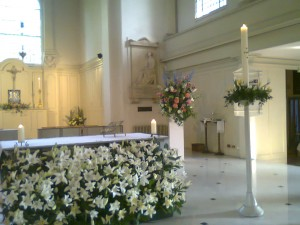 St John's Wood sanctuary, with a display of lilies in front of the altar