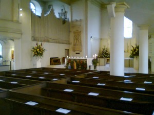 The organ console and pipes on the left of the sanctuary