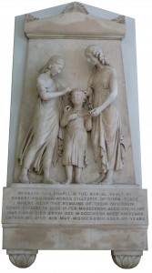 One of the monuments in St John's Wood Church; a young girl is flanked by an older girl and a woman above.