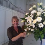 Vivien Turner, arranging a flower display for the church