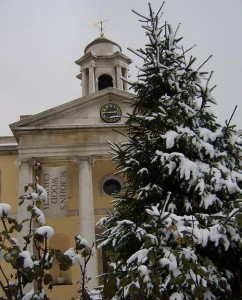The facade St John's Wood Church, behind a snow-covered Christmas tree